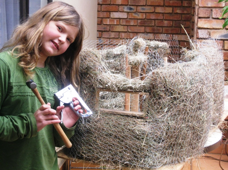 JJ and her hay bale dolls house